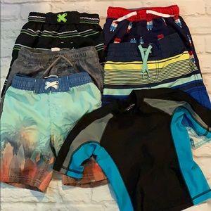 5 prs boys board shorts and 1 rash guard. Sz 4/5